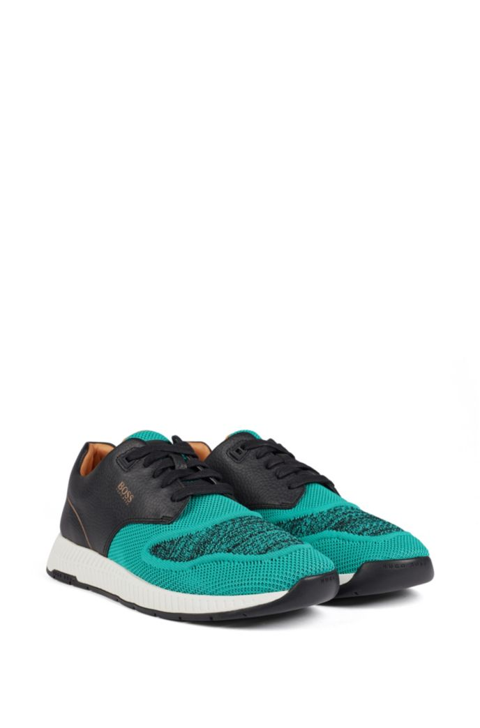 Two-tone sneakers in knitted fabric and grained leather