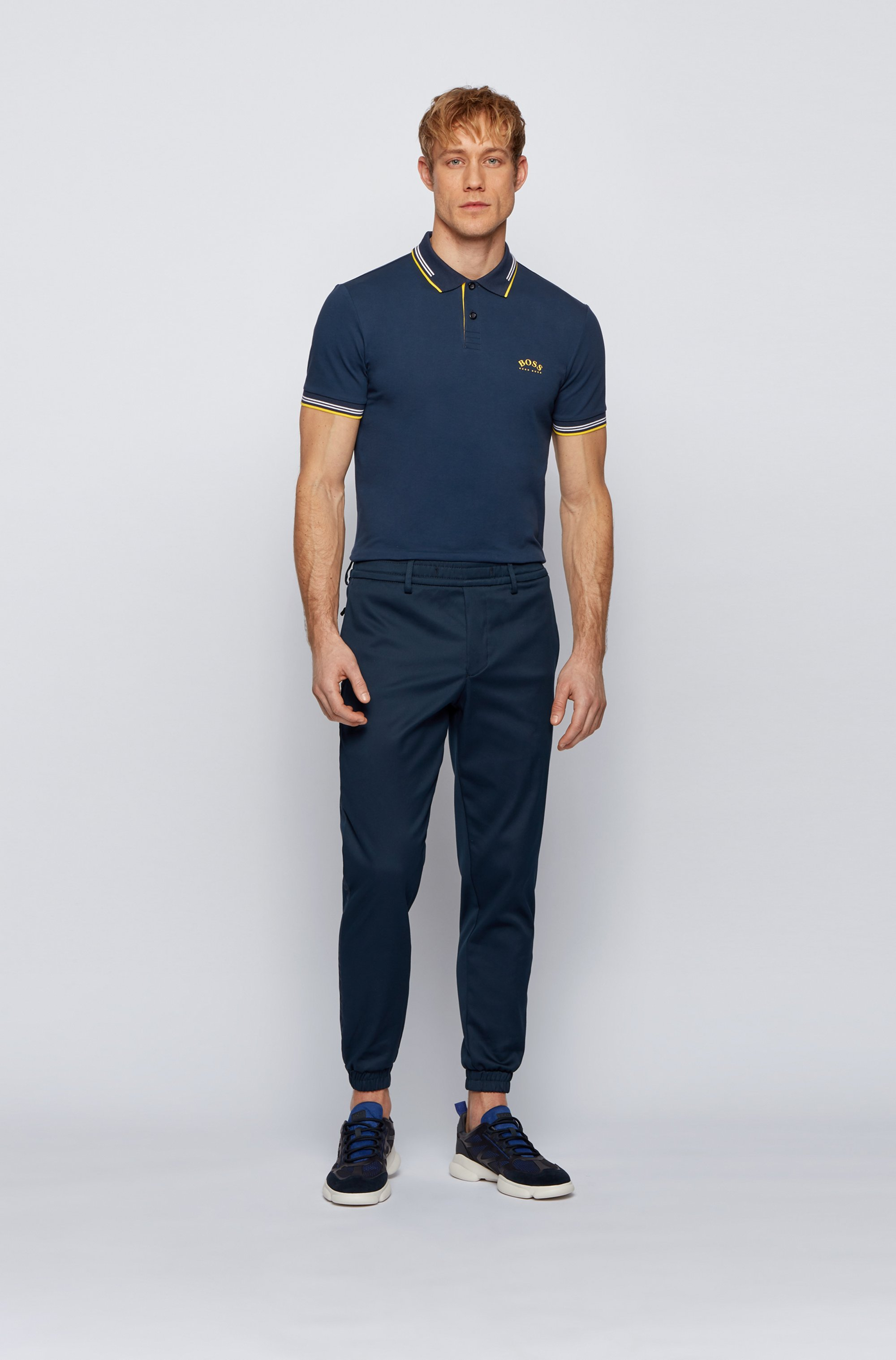Slim-fit polo shirt in stretch piqué with curved logo