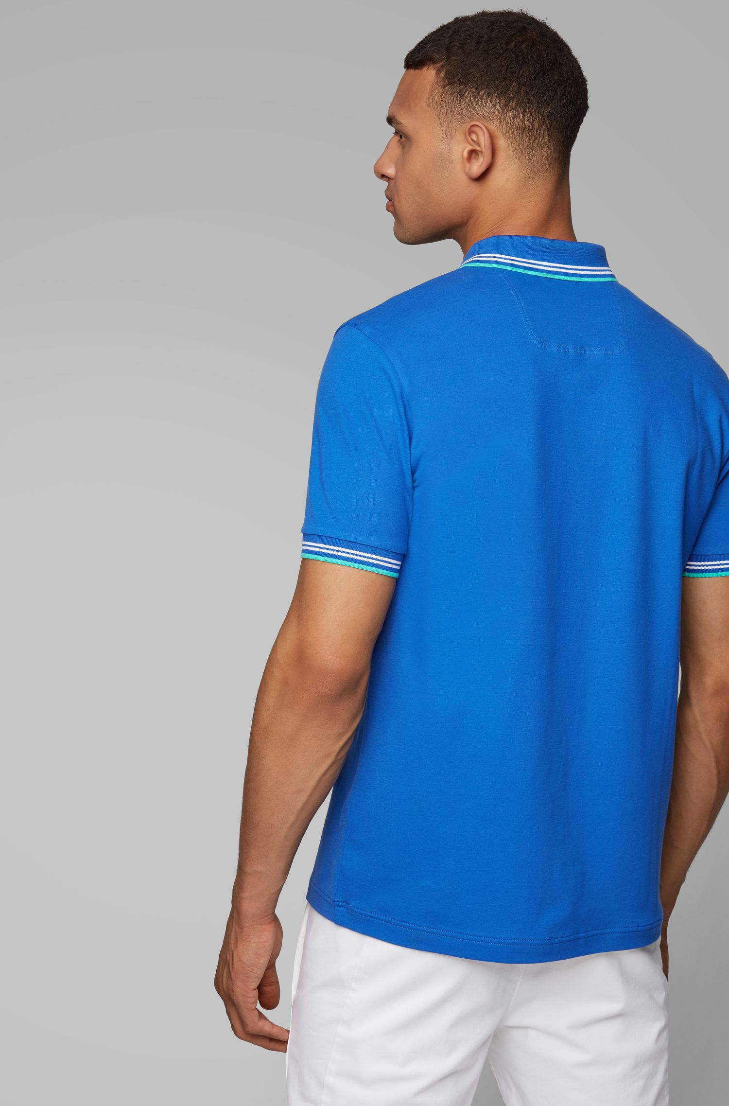 Slim-fit polo shirt in stretch piqué with curved logo, Blue