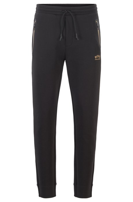 Half-cuffed jogging pants with curved logo, Black