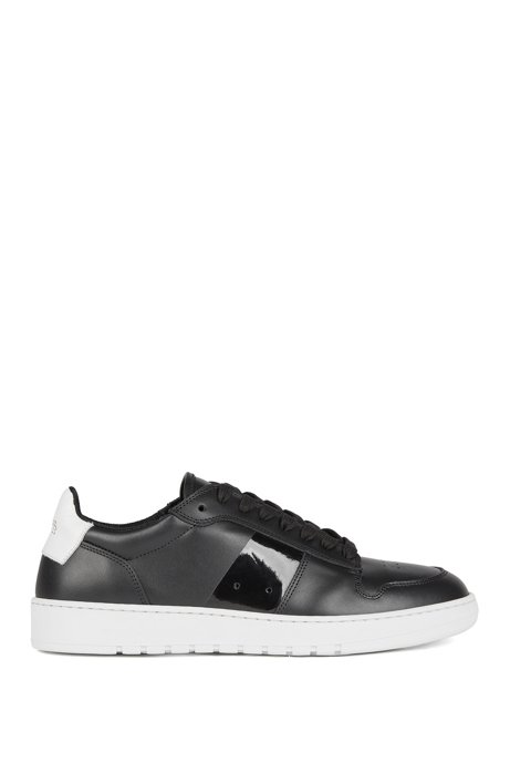 Low-top sneakers in calf leather with perforated details, Black