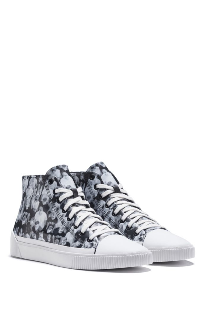High-top sneakers with crowd-scene graphics