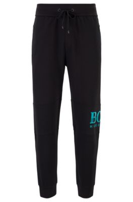 Drawstring loungewear pants in knitted piqué with textured logo, Black