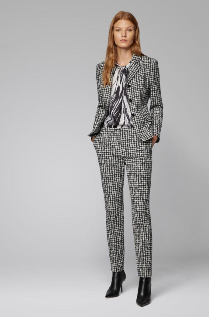 Sleeveless top in zebra-print Italian twill