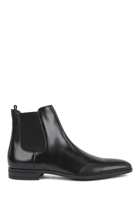 Chelsea boots in burnished leather with laser-cut details, Black