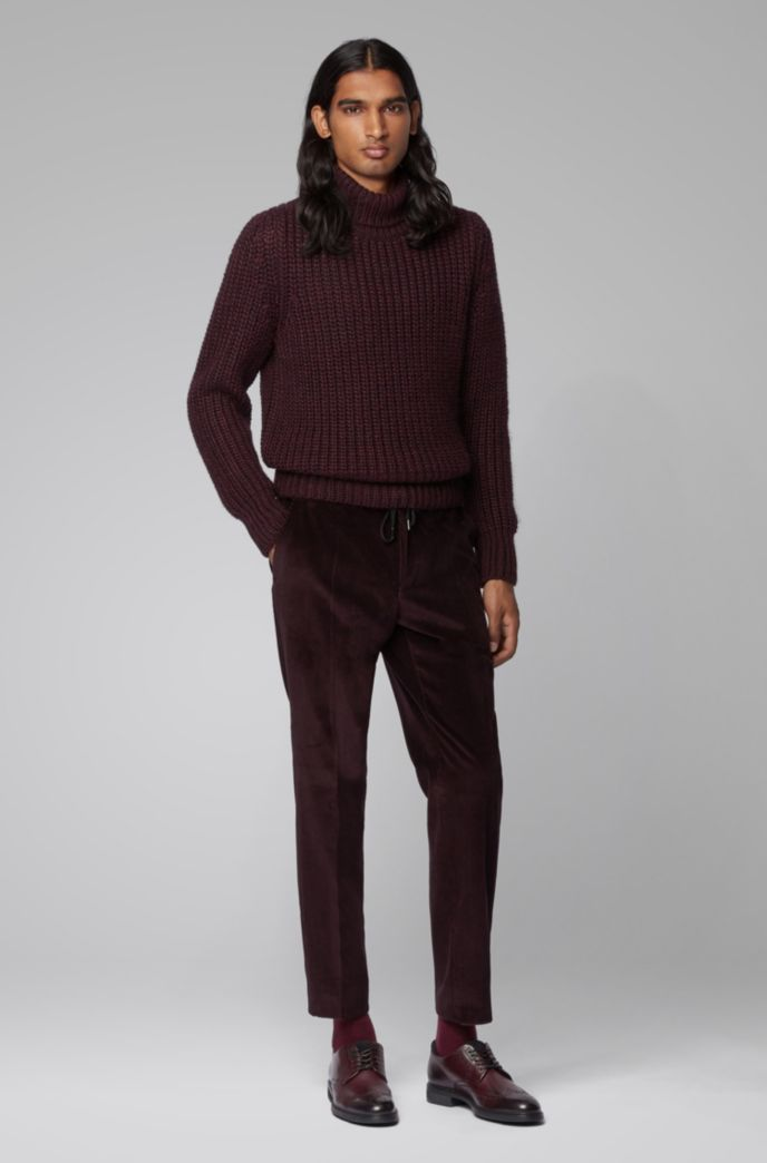 Rollneck sweater in mixed chunky-knit structures