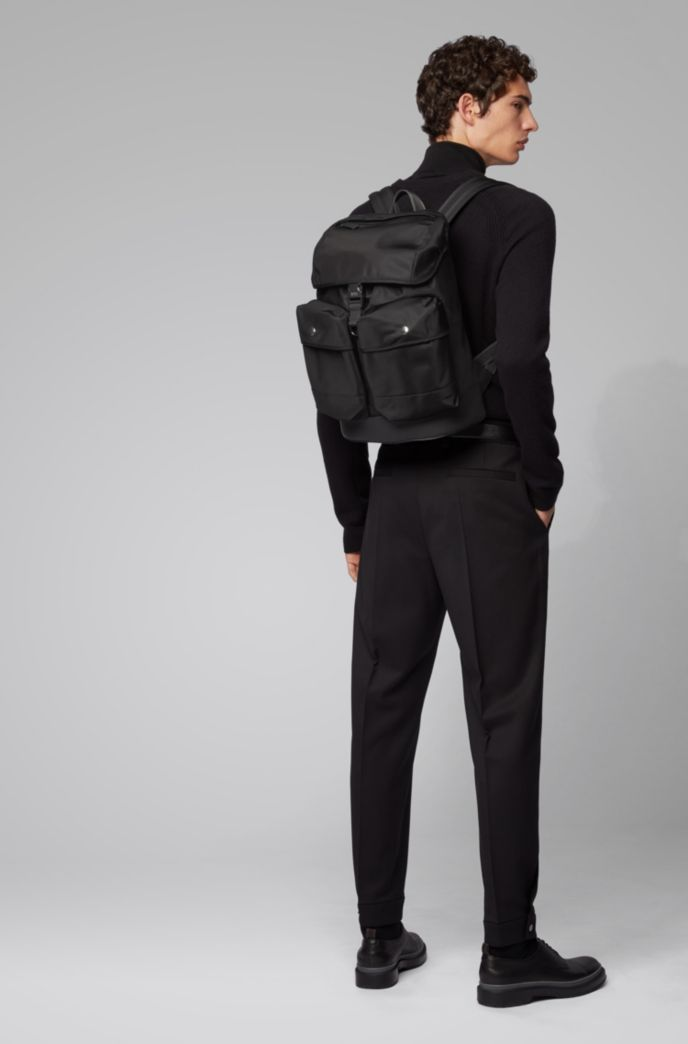 Multi-pocket backpack in nylon gabardine with flap closure