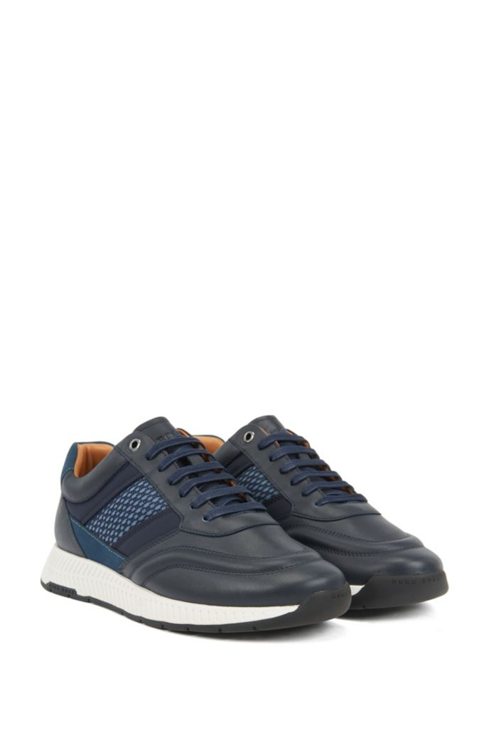 Mixed-leather sneakers with injected monogram motif