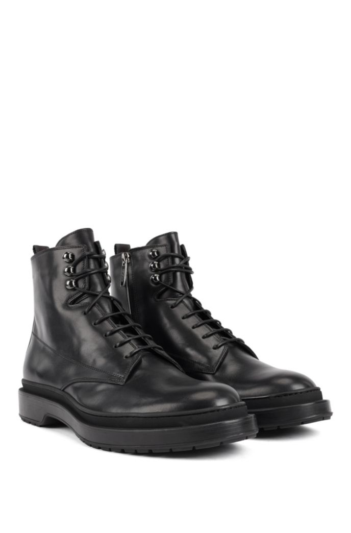 Lace-up boots in leather with shearling lining
