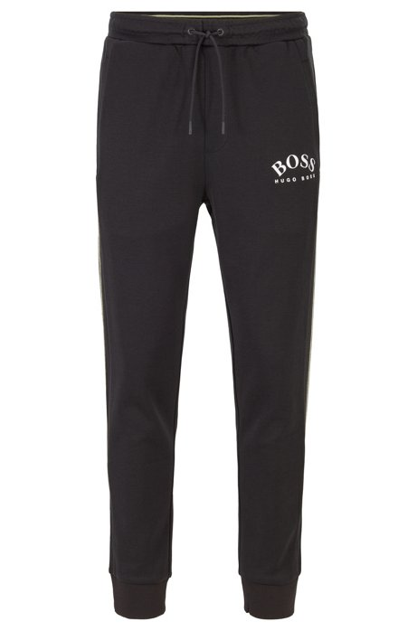Slim-fit jogging pants with curved logo, Black
