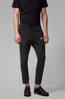 Slim-fit jogging pants with curved logo, Black