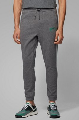 Slim-fit jogging pants with curved logo, Grey