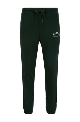 Slim-fit jogging pants with curved logo, Light Green