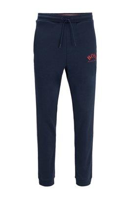 Slim-fit jogging pants with curved logo, Dark Blue