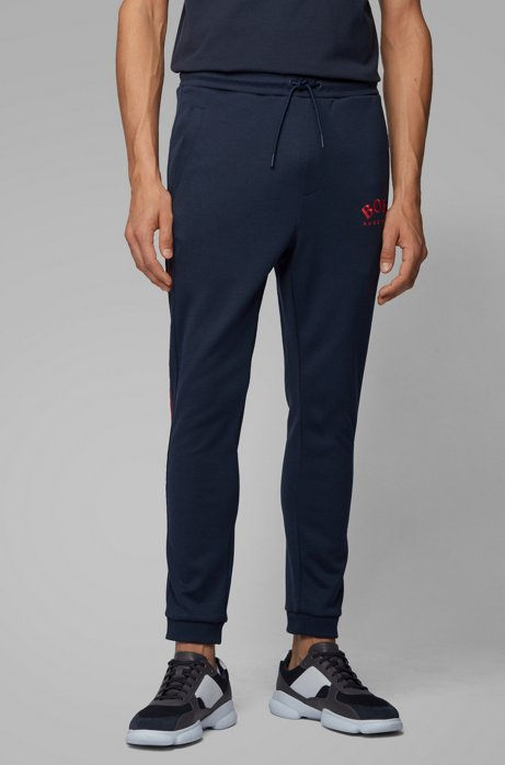 Slim-fit jogging pants with curved logo, Dark Blue