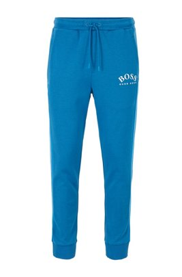 Slim-fit jogging pants with curved logo, Blue