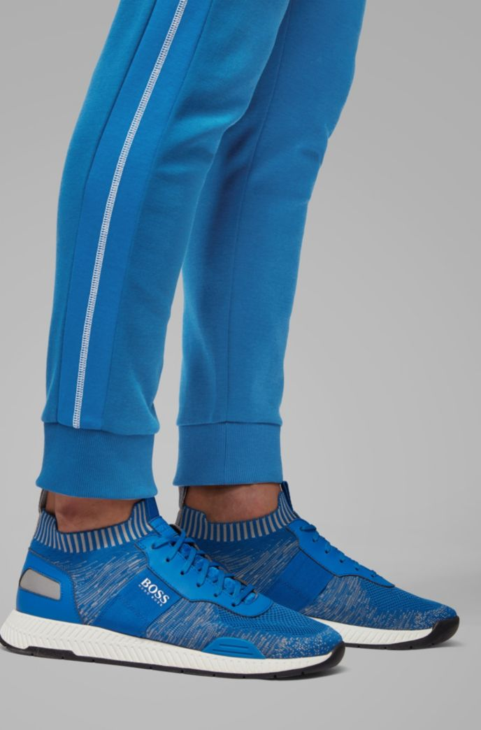 Slim-fit jogging pants with curved logo
