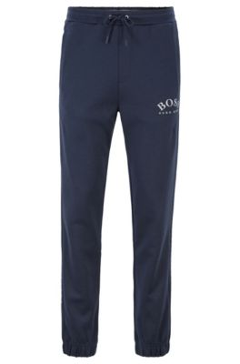Slim-fit jogging pants with logo and cuffed hems, Dark Blue