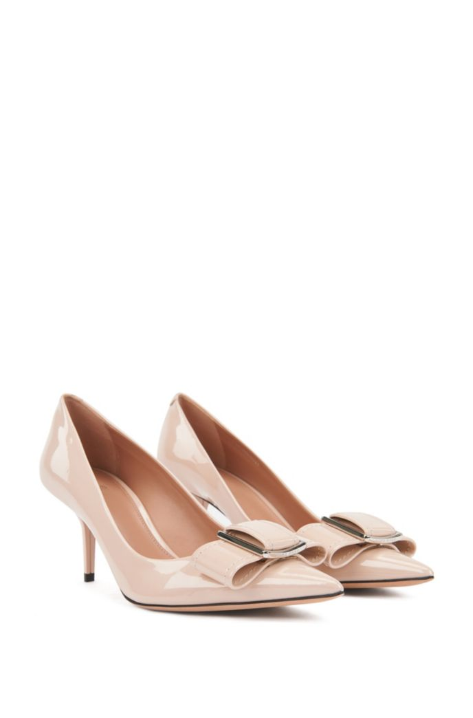 Heeled pumps in patent Italian leather with bow embellishment