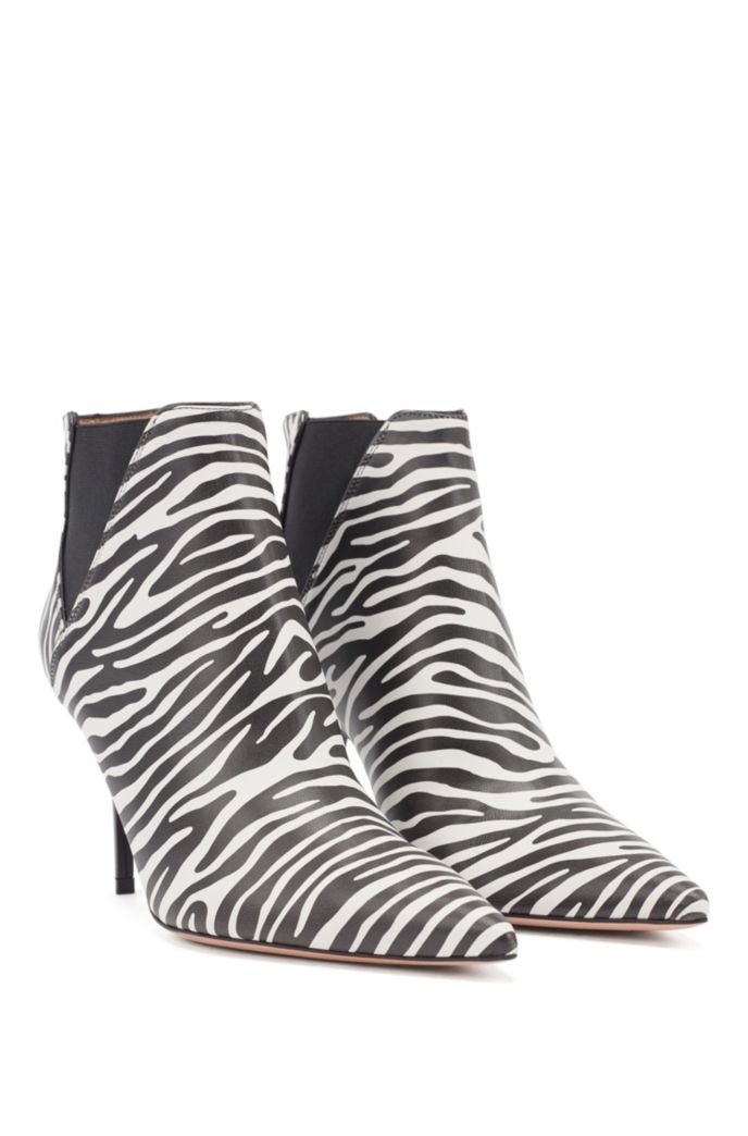 High-heeled ankle boots in zebra-print leather