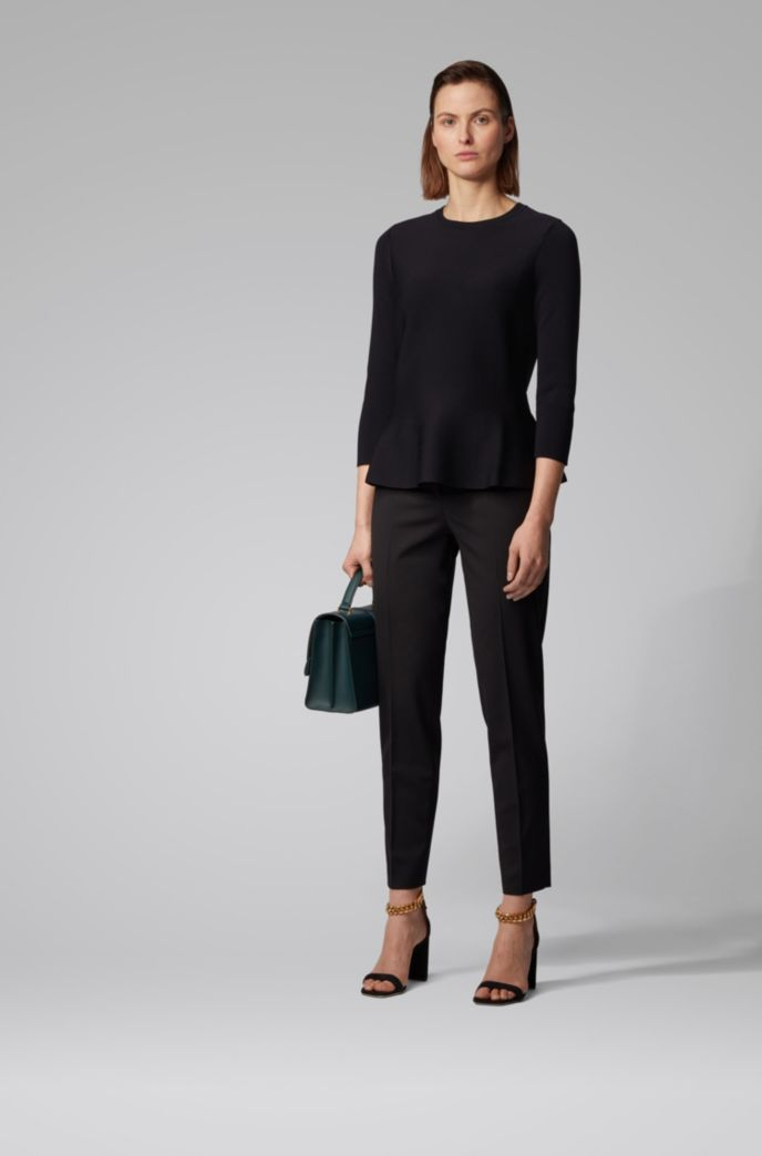 Slim-fit sweater with peplum hem and crew neckline