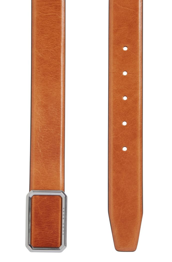 Leather belt with closed buckle in polished silver-tone hardware