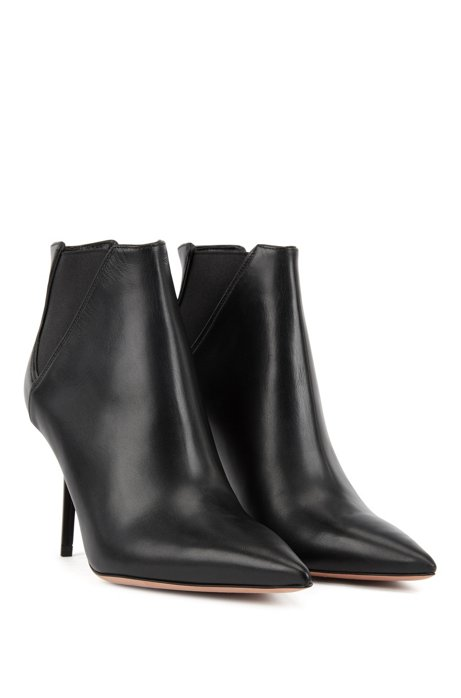 High heeled ankle boots in leather with elastic panels