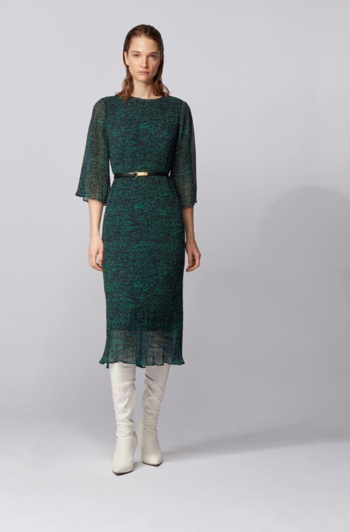 Dot-print plissé dress with volant details