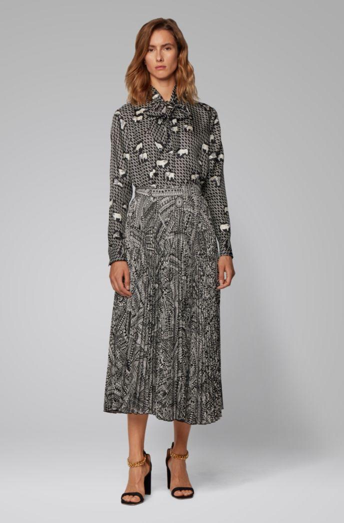 Midi-length plissé skirt with collection print