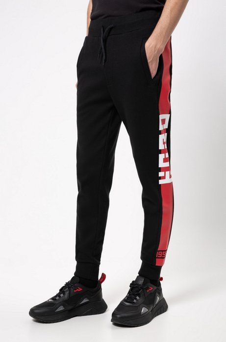 Interlock-jersey pants with contrast side stripe, Black