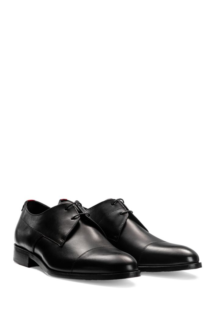 Leather Derby shoes with red-accented sole