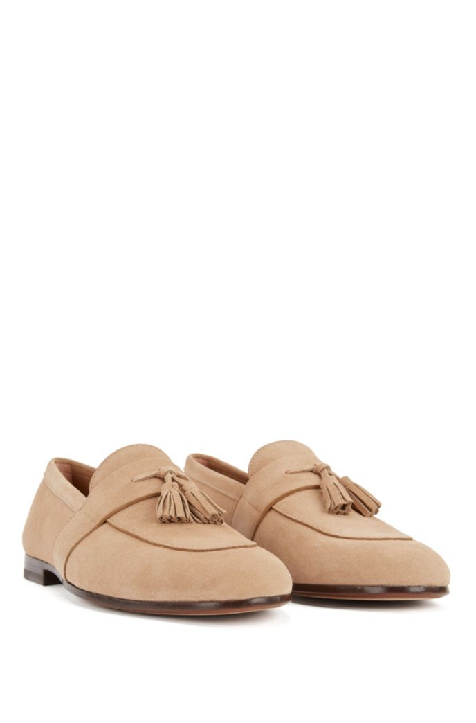 Suede loafers with tassel trim