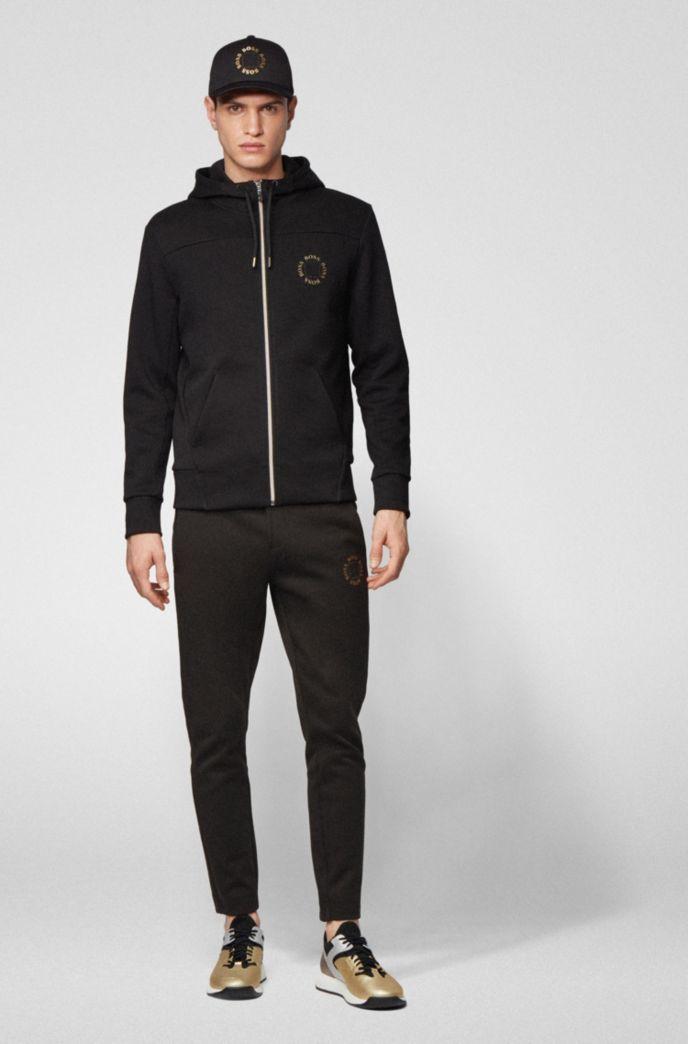 Regular-fit jogging pants with layered metallic logo