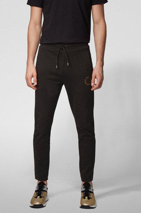 Regular-fit jogging pants with layered metallic logo, Charcoal