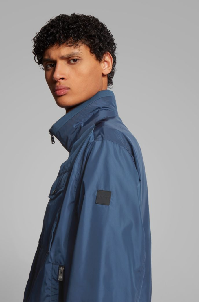 Water-repellent jacket in high-shine fabric