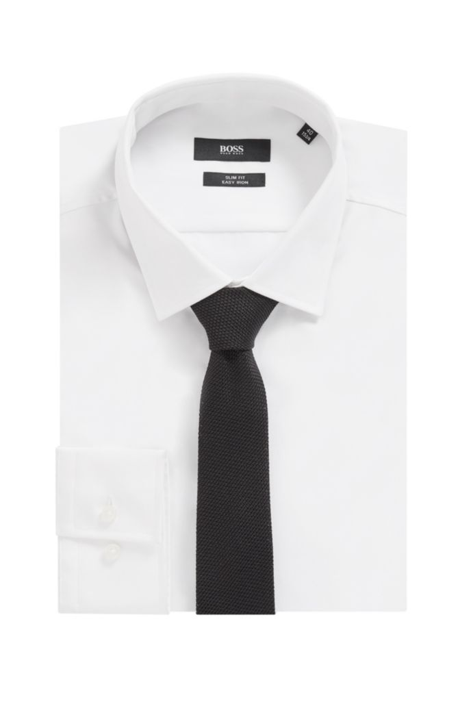 Italian-made tie in silk jacquard with rolled hem