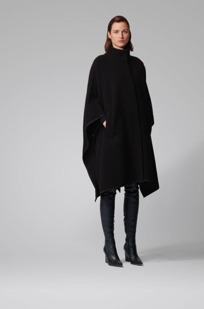 Oversized-fit poncho in a felted wool blend
