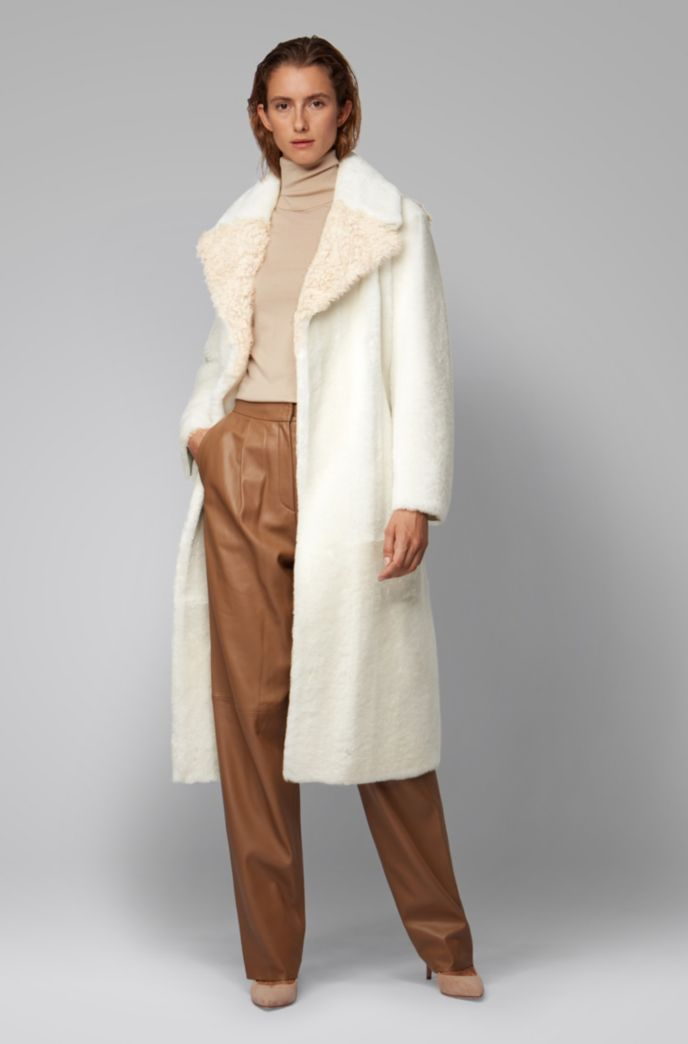 Longline patched coat in Toscana and lambskin shearling