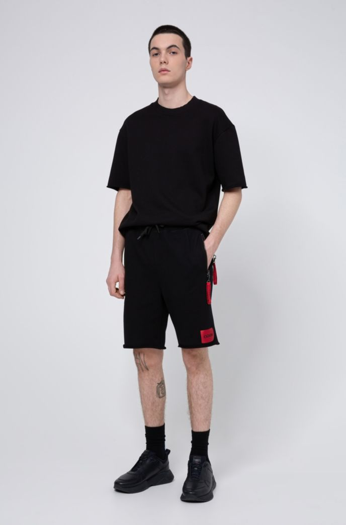 Raw-hem shorts with detachable collection key ring