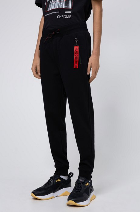 Jogging pants in cotton with detachable collection key ring, Black
