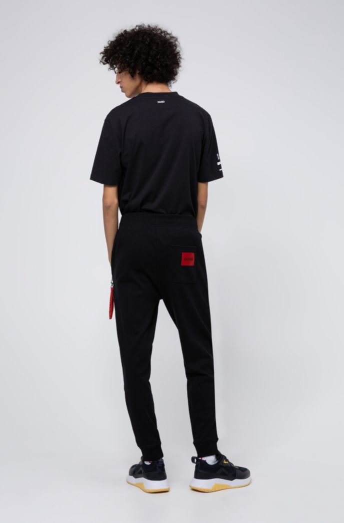 Jogging pants in cotton with detachable collection key ring