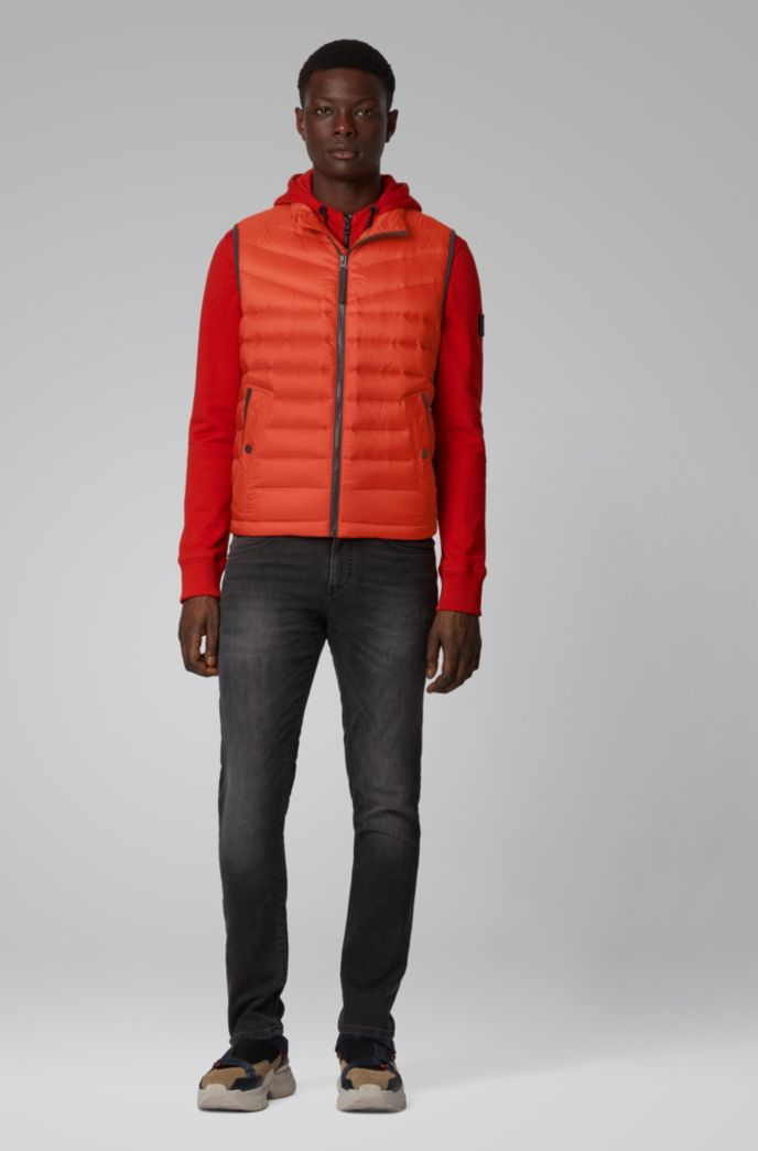 Down-filled gilet with water-repellent outer