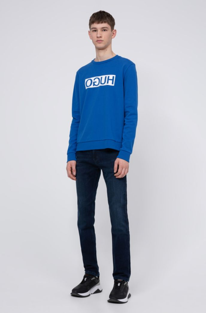 Slim-fit jeans in knitted denim with reverse logo