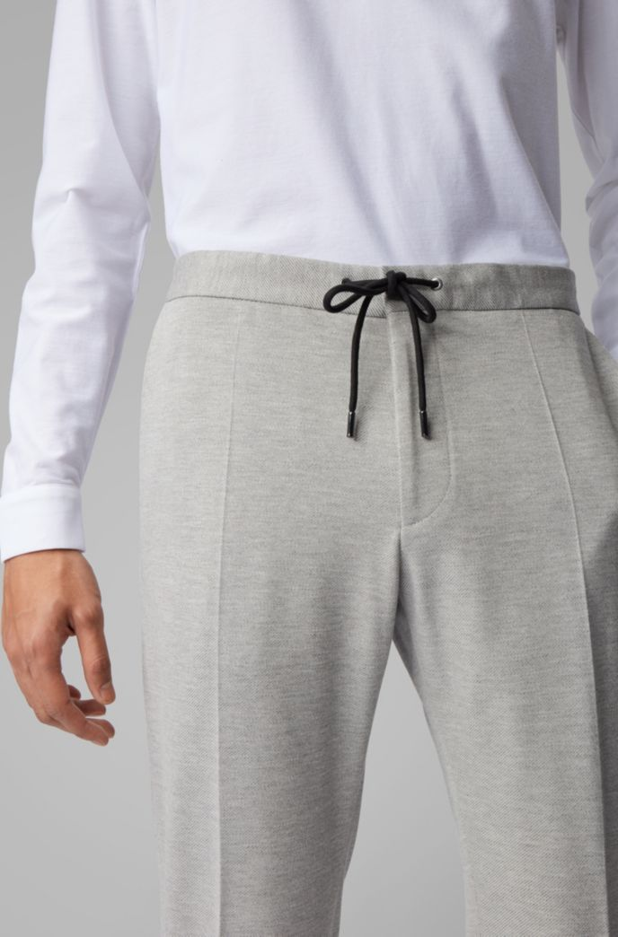 Slim-fit pants in stretch fabric with elasticated waistband