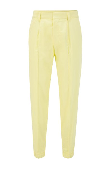 Cotton tapered-fit pants with zip-detail cuffed hems, Yellow