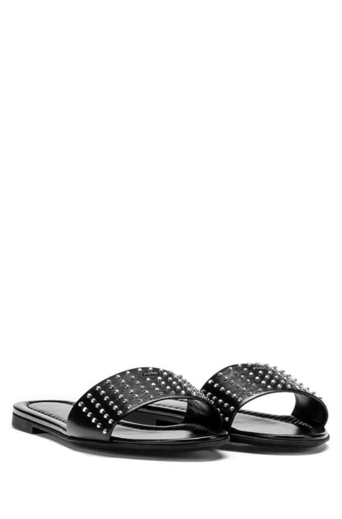 Italian-made leather slides with metal stud detailing