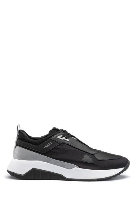 Chunky-soled sneakers in mixed materials, Black
