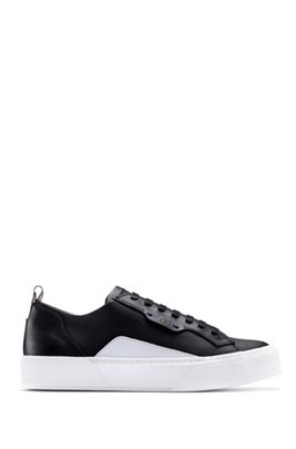 Tennis-inspired sneakers in coated fabric and calf leather, Black
