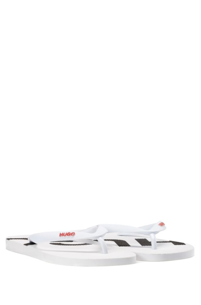 Rubber flip-flops with contrast logos