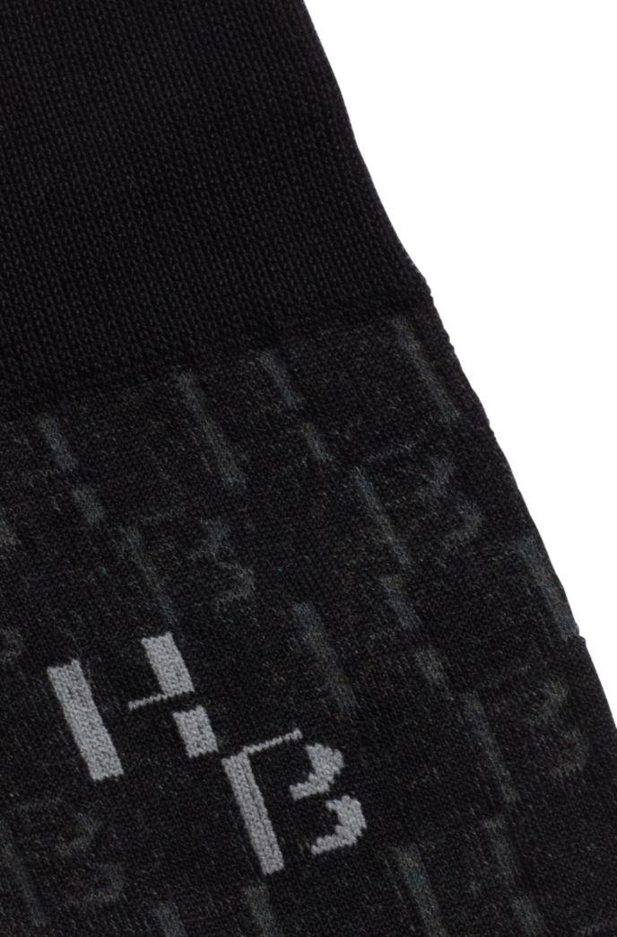 Regular-length socks with two-tone monogram pattern